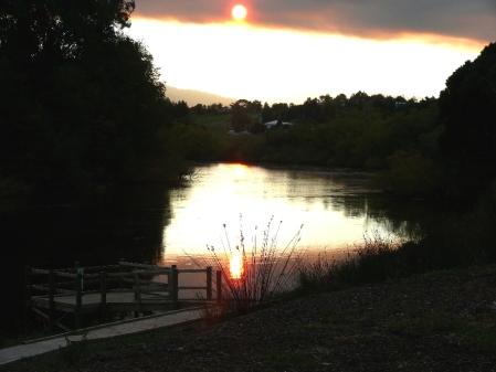 Sun through smoke haze and reflecting off Derwent River.