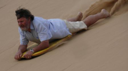 As a teenager I had a sit down sand ski. Braking and turns were controlled by fingertips not toes.