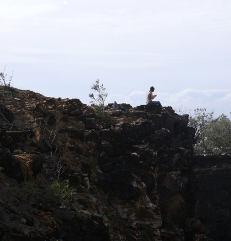 Girl on cliff edge at Devils Kitchen.