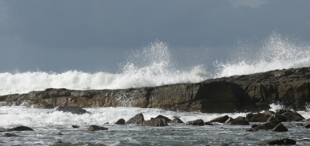 Big waves still grind away at the beach and rocks.