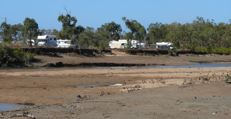 Low tide and campsite viewed from the opposite bank.