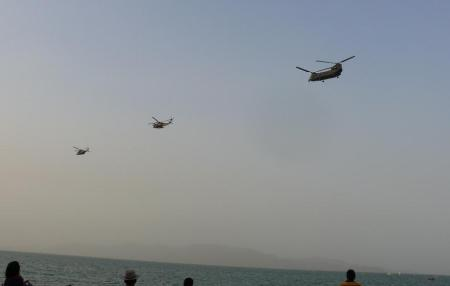 Wave goodbye as the helicopters leave.