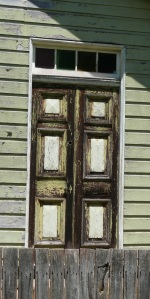 Weathered, aged and personality door on an equally aged and weathered private house in Ebor New England district of northern New South Wales.