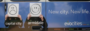 The Smiley and UnSmiley faces on the back of the bus.