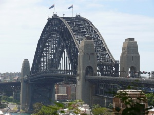 Sydney Harbour Bridge in sunshine glory. If you double click on the image to enlarge full size you will be able to see at least seven Bridge Climb Groups at various places on the arch.
