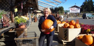 Donnis loves carving pumpkins for Halloween and looks for the biggest pumpkin.