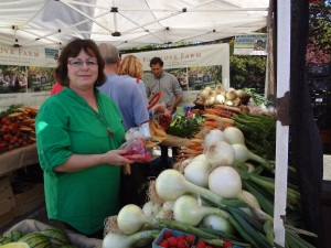 Joan inspecting organic crops at one of the many markets they visited on Vancouver Island and Salt Spring Island.