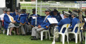 The Arfmidale City Band sits quietly waiting for the boring stuff to finish so they can do their thing and they too can finish.