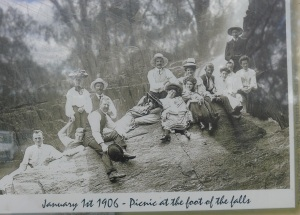 Old photograph of a New Years Day party in 1906. Imagine the effort of getting to the falls then climbing down the only accessable rock face to picnic beside the falls. There were no roads to the falls in those days. No staircases, viewing platforms or safety fences.
