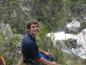 Jason sitting rock ledge above upper Apsley Falls.
