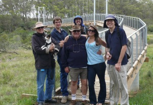 Taylor Tribe at the suspension bridge over Apsley River. Linda with Ella the dog, Jason, Iain, Greg, Alesha and Justin