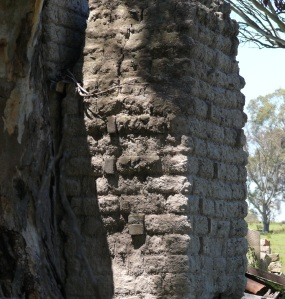 The collapsed house has a poor example of mud brick and regular kiln fired bricks in this chimney.