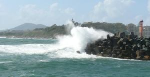 Waves breaking over rockwall at Forster