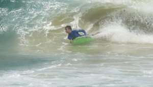 Boogie board rider on wave formed by storm swell.