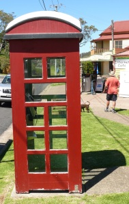 Old red telephone box which were once common throughout towns and suburbs of Australia.
