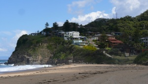 Southern end of Stanwell Park Beach with the houses perched on the clifftops.