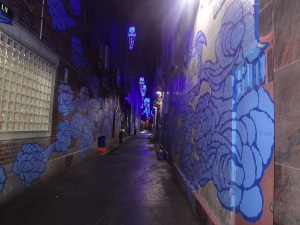 Sculptued footpath, walls and airspece in a Chinatown Alley.