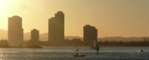 Setting sun highlights the tall buildings overlooking The Broadwater at Biggera Waters.