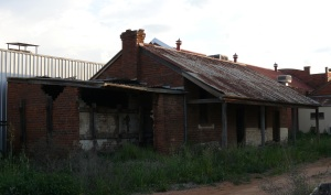 Typical stables and dunny behind Coolamon shops.