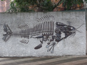 Fossil artwork made from metal machinery scraps.