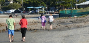 Glenda and Donnis walking in the sand on The Broadbeach on the Gold Coast.