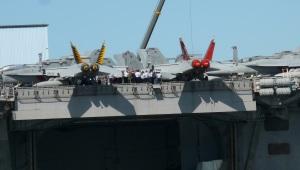 Planes arriving on deck.