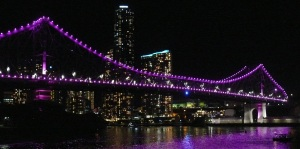 The Story Bridge lit up with LED lights which change in a routine which can be set to almost any colour in the spectrum.