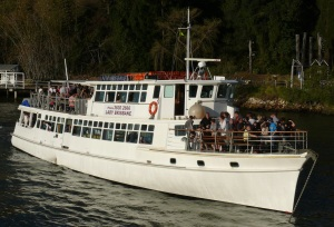 Another of the many passenger boats with happy  tourists.