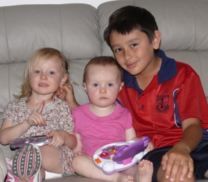 Amelia, Hannah and Chris. Cousins who have met for the first time.