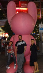 Chris Peter and Regelyn Queen Street Mall, Brisbane City. This pink rabbits have popped up in various locations around the city and suburbs. So far noboby has revealed why they were installed in the early hours of the morning.