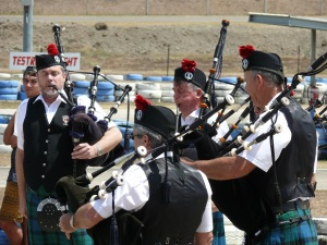 The Mackay Pipe and Drum Band coping with the heat.