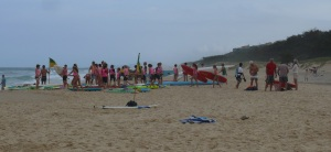 Misty salt laden view of young surf club members at Sunshine Beach.