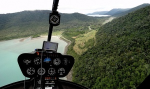 Aerial approach via Funnel Bay to Whitsunday Airport  upper right.