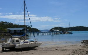 Catamaran on the beach at Shute Harbour.