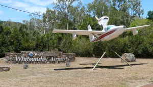 Entrance to Whitsunday Airport and Whitsunday Airport Village Environment.