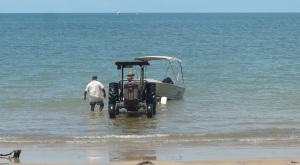 Most residents of Midge Point love to fish and most of them have a tractor to launch and retrieve their boat.
