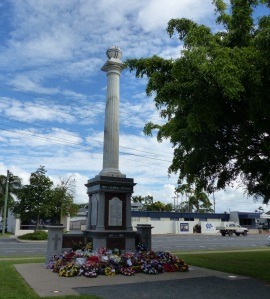 Mackay Cenotaph with floral remembrance tributes.
