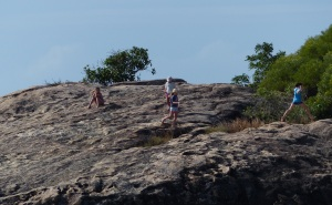 Children playing atop the steep and slippery rocks at Horseshoe Bay.