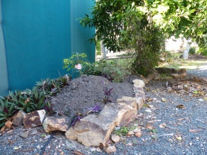 The rock edging around the small garden beside the garage.