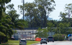 "Looking north along our road on the way to Airlie Beach. The big cruise ship ""PACIFIC DAWN"""
