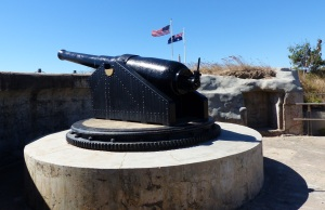 The second of the 6 inch guns with Australian and USA flags, the two nations who defended Australia against the Japanese in the Battle of the Coral Sea.