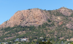 Castle Hill in close up. If you enlarge the photo you can see a white Saint figure near the top left hand side. This was painted by a bunch of daring University students from Mackay almost 30 years ago.