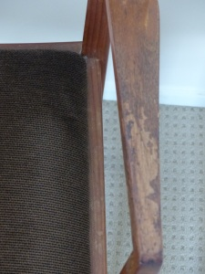 Look at the closeup of the timber arms on the chair. This was the typical condition of the eight chairs.