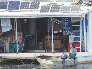 Closeup of houseboat rear deck. Essential gear or umm err junk?