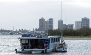 Here is the houseboat up a little closer. Note the small yacht rafted alongside.