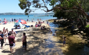 Bundeena Creek runs into Port Hacking at Bundeena Beach.
