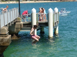 Boys jumping off the jetty at Bundeena.