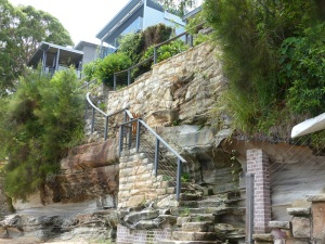 Sandstone cliffs, wall and staircase at Gunyah Beach.
