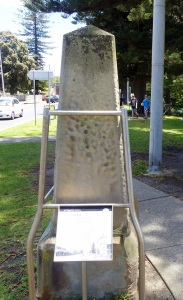 Relocated sandstone marker obelisk at Kiama.