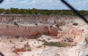 "The open cut mine site ""Lunatic Hill"" showing different layers of a 120,000,000 million year old inland sea."